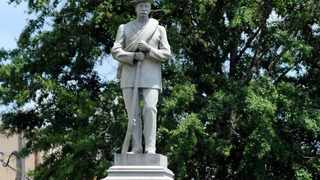 FILE - This Thursday, June 28, 2018 file photo shows a Confederate monument dedicated in 1909 standing in the middle of the square in Tuskegee, Ala.. Following nationwide protests over the police killing of George Floyd and an attack on the monument by vandals, the chairman of the Macon County Commission said officials will cover the memorial with a tarp and are looking for ways to remove it. (AP Photo/Jay Reeves, File)