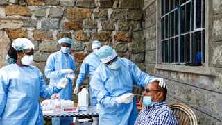 (200609) -- NAKURU, June 9, 2020 (Xinhua) -- Public health workers go about their work in collecting swab samples for COVID-19 testing, from workers in the hospitality industry in Rongai, Nakuru County, Kenya, June 6, 2020. Kenya has heightened COVID-19 testing on high-risk groups to help contain the spread of the virus. (Xinhua/Sheikh Maina)