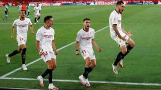 Sevilla's Lucas Ocampos celebrates scoring their first goal with teammates. Picture: Marcelo Del Pozo/Reuters