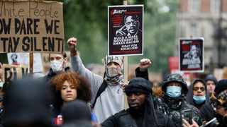 Demonstrators hold signs as they march during a Black Lives Matter protest in London, following the death of George Floyd who died in police custody in Minneapolis. Picture: John Sibley/Reuters