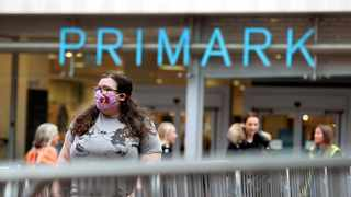 Long queues of shoppers snaked outside some stores in England from early in the morning on Monday, with discount fashion retailer Primark proving a big draw. Photo: File