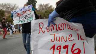 Nearly 200 young South Africans, wearing face masks and keeping a distance, marked the country's Youth Day holiday, the 44th anniversary of the 1976 Soweto students' uprising which helped to bring about the end of the country's previous regime of racist, minority rule. Picture: Themba Hadebe/AP/African News Agency (ANA)
