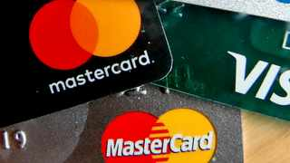 The U.K.'s top judges ruled in favor of retailers including J Sainsbury Plc in a blow to credit-card companies that could now face billions of pounds in damages.   (AP Photo/Keith Srakocic, File)
