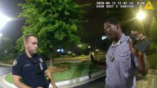 This screengrab taken from body camera video provided by the Atlanta Police Department shows Rayshard Brooks speaking with Officer Garrett Rolfe, left, in the parking lot of a Wendy's restaurant late Friday, June 12, 2020, in Atlanta. Picture: Atlanta Police Department via AP
