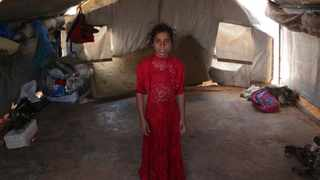 Ranim Barakat, a nine-year-old displaced Syrian girl from Hama countryside, poses for a picture in a tent at Atmeh camp, near the Turkish border. Picture: Khalil Ashawi/AP