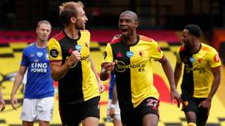 Watford's Craig Dawson, left, celebrates after scoring his side's equalising goal during their English Premier League match against Leicester City at Vicarage Road Stadium in Watford on  Saturday. Photo: Alastair Grant/AP