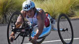 FILE - Alex Zanardi of Italy rides during the cycling portion of the Ironman World Championship Triathlon, in Kailua-Kona, Hawaii. Racecar driver turned Paralympic champion Alex Zanardi has been seriously injured again. Police tell The Associated Press that Zanardi was transported by helicopter to a hospital in Siena following a road accident near the Tuscan town of Pienza during a national race for Paralympic athletes on handbikes. The 53-year-old Zanardi had both of his legs amputated following a horrific crash during a 2001 CART race in Germany. He was a two-time CART champion. Photo: Mark J. Terrill/AP