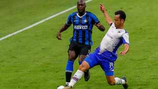 Inter Milan's Romelu Lukaku, left, and Sampdoria's Maya Yoshida fight for the ball during their Serie A  at the San Siro. Picture: Antonio Calanni/AP