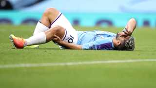 Manchester City's Sergio Aguero reacts as he lies on the pitch injured during their English Premier League match against Burnley at the Etihad Stadium on Monday. Photo: Martin Rickett/AP