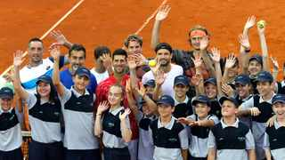 FILE - In this photo taken on Friday, June 12, 2020, Serbia's Novak Djokovic, centre, poses with volunteers and players during the Adria Tour charity tournament in Belgrade, Serbia. Photo: Darko Vojinovic/AP