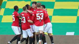 Manchester United's Harry Maguire celebrates with team-mates after scoring the winning goal in their FA Cup clash against Norwich City at Carrow Road on Saturday. Photo: Catherine Ivill/AP