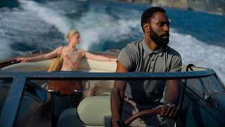 "This image released by Warner Bros. Entertainment shows Elizabeth Debicki, left, and John David Washington in a scene from ""Tenet."" Warner Bros. Picture: Melinda Sue Gordon/Warner Bros. Entertainment via AP"