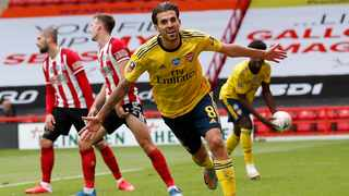 Arsenal's Dani Ceballos, front, celebrates after scoring the winning goal during their FA Cup sixth round game against Sheffield United at Bramall Lane on Sunday. Photo: Andrew Boyers/AP