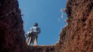 A worker stands next to a freshly-dug grave at the Honingnestkrans Cemetery, North of Pretoria.  Gauteng Health MEC Dr Masuku unnecessarily deemed it wise to talk of the more than 1.5 million grave sites he is preparing in Gauteng. Picture: Shiraaz Mohamed/AP