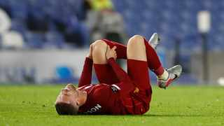 Liverpool's Jordan Henderson reacts during the English Premier League soccer match between Brighton and Liverpool at Falmer Stadium in Brighton on Wednesday, July 8, 2020. Photo: AP Photo/Paul Childs