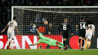 Marcus Rashford beats Gianluigi Buffon with a penalty to clinch victory for Manchester United against PSG on Wednesday night. Photo: Yoan Valat/EPA