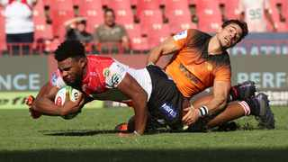 Vincent Tshituka of the Lions tackled by Joaquin Diaz Bonilla of the Jaguares. Photo: Gavin Barker/BackpagePix