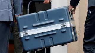 Men unload a case containing the black boxes from the crashed Ethiopian Airlines Boeing 737 MAX 8 outside the headquarters of France's BEA air accident investigation agency. Picture: Reuters/Philippe Wojazer/File Photo