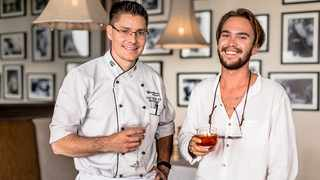 Grant van der Riet, the executive chef at Southern Sun Hyde Park, left, shares a drink with Matt Beech at the Autograph Gin launch. Picture: Supplied