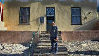 PhD scholar Halim Gencoĝlu outside the Bo-Kaap Museum at 71 Wale Street. His archival research reveals a case of mistaken identity in the museum's ownership.