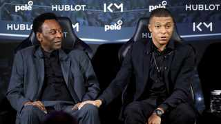 French soccer player Kylian Mbappe and Pele pose ahead of their meeting in Paris. Photo: REUTERS/Christian Hartmann