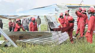 Red ants demolishing illegal shacks. Two people were killed after the Red Ants clashed with Rustervaal residents during an eviction. File picture: Sisonke Mlamla.
