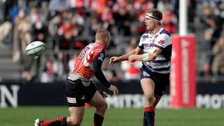 Captain Dane Haylett-Petty (right) scored one of the four Rebels tries against the Reds on Friday. Photo: Kiyoshi Ota/EPA