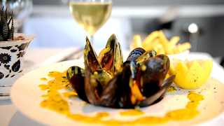 Belgium-style half shell mussels in garlic, lemon and parsley served with chips. Picture by Nokuthula Mbatha