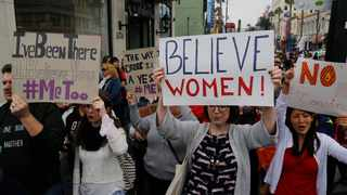 Participants march against sexual assault and harassment at a #MeToo March. File picture: Damian Dovarganes/AP