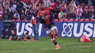 Aphiwe Dyantyi leaves the Stormers scrumhalf Herschel Jantjies in his wake to score for the Lions at Ellis Park last week. Photo: Chris Kotze/BackpagePix