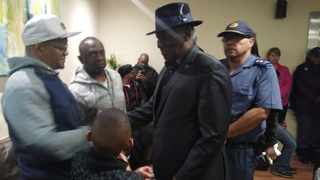 Police Minister, Bheki Cele was seen greeting the families of the Anti-Gang Unit members who were shot at this morning in Samora Machel.