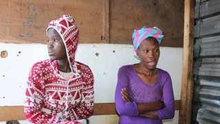 Sixteen-year-old Akhona Mncedane (left) after losing her four-month-old baby. Her mother, Thandiwe, says they do not have the money to bury the child. Photo: Velani Ludidi/GroundUp