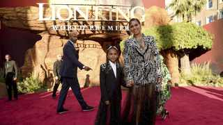 Beyonce held onto Blue as they walked the red carpet. Picture: Chris Pizzello/Invision/AP