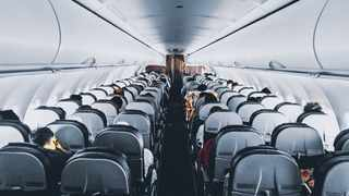 Passengers synchronise their disembark from plane. Pexels