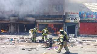 Firefighters battle to put out fires in Pretoria CBD after a protest and looting. Picture: James Mahlokwane