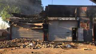 One of the shops that were burnt during the unrest in Malvern. Picture: @crimeairnetwork Twitter ·