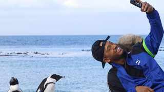 Television personality Terrence J at Boulders Beach during his recent SA trip. Picture: Instagram.