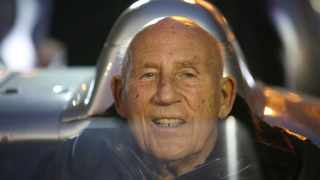 Sir Stirling Moss at the wheel of his Mercedes 300 SLR in 2015.