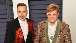 Sir Elton John and his husband David Furnish. Picture: Bang Showbiz