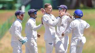 George Linde (centre) was the pick of the Cobras bowlers. Photo: Christiaan Kotze/BackpagePix