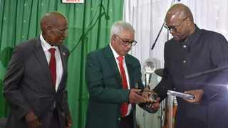 Yusuf Bhamjee receives the Andrew Mlangeni Green Jacket for his services in sports activism during the apartheid struggle.