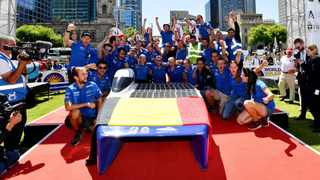 Belgian Agoria Solar Team members at the finish line of the 2019 World Solar Challenge in Adelaide. Picture: AAP Image/David Mariuz/via Reuters.