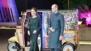Britain's Prince William and his wife Kate arrive in a traditionally painted motorized rickshaw to attend a reception in Islamabad, Pakistan, Tuesday, Oct. 15, 2019. They kicked off a five-day tour of Pakistan on Tuesday amid much fanfare and tight security. (AP Photo/B.K. Bangash)