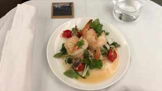 Poached prawns with chili and lime, designed to wake passengers up. Pictures: Angus Whitley/Bloomberg