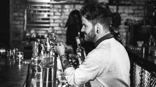Julian Short, head mixologist and co-owner of Sin+Tax at work behind the bar. Picture supplied.