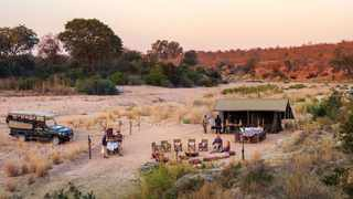 The riverbed provides unobstructed views across the wilderness where guests may see game passing by. Picture: Supplied