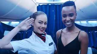 Flight attendant Charissa Cooper shot of Miss Universe Zozibini Tunzi went viral. Picture: I'm Staying Facebook page.