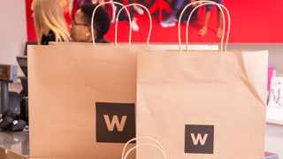 Woolworths has announced the second phase of its trial of specially-designed paper bags for fashion, beauty and homeware purchases. Photo: Supplied