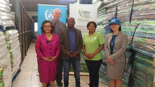 Acting Executive Mayor Abel Tau, centre, and the City of Tshwane receive donations from the United Nations in aid of residents affected by the recent floods. Picture: James Mahlokwane