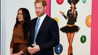 Britain's Prince Harry and Meghan, Duchess of Sussex look at an art exhibition by Indigenous Canadian artist Skawennati in the Canada Gallery, during their visit to Canada House to meet with Canada's High Commissioner to the UK, Janice Charette. Picture: Daniel Leal-Olivas/Pool Photo via AP.